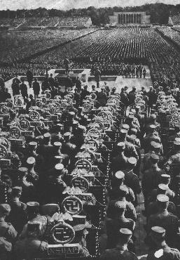 Rows of SA standard bearers line the field behind the speaker's podium at the 1935 Nazi Party Congress. Nuremberg, Germany, September 1935.