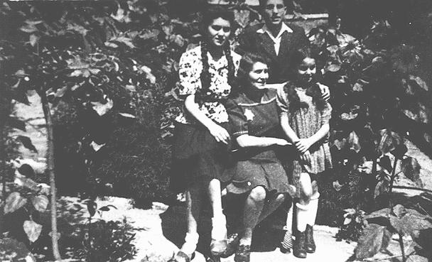 The Aigner family of Nove Zamky, Czechoslovakia. Laszlo (Leslie) Aigner (standing, back) survived the Auschwitz camp; his mother (seated) and sister Marika (standing, right) were gassed there. May 1944.