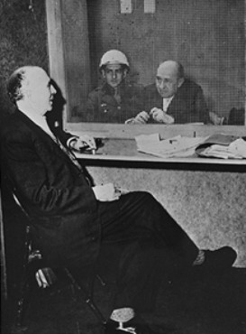 Among the many ironies of the International Military Tribunal was that the defendants were accorded that which they had denied their opponents: the protection of the law and a right to due process. Here, defendant Walther Funk, former German Minister of Economics, speaks with his defense attorney, Dr. Fritz Sauter, in a visitation room at Nuremberg.