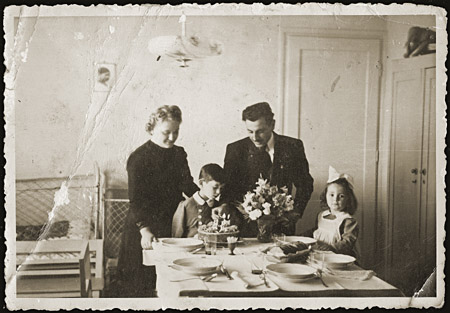 Gavra Mandil celebrates his fourth birthday with his parents, Mosa and Gabriela, and sister Irena. Novi Sad, Yugoslavia, September 6, 1940.