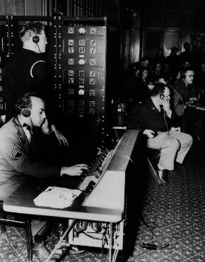 English, French, Russian, and German were official languages of the Nuremberg trials. Translators provided simultaneous translations of the proceedings. Here, they route translations through a switchboard to participants in the trial. Nuremberg, Germany, November 1945.