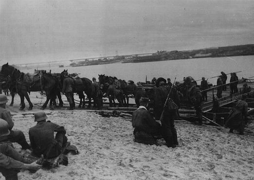 German forces and supplies at a river crossing on the way to the front. Soviet Union, October 1941.