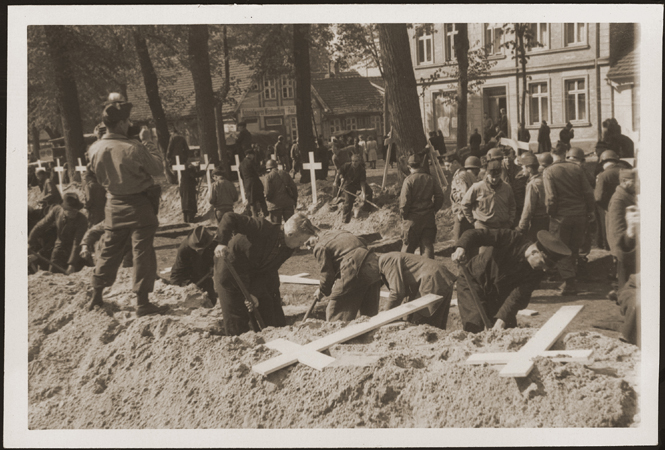 After the liberation of the Wöbbelin camp, US troops forced the townspeople of Ludwigslust to bury the bodies of prisoners killed in the camp. Germany, May 7, 1945.
