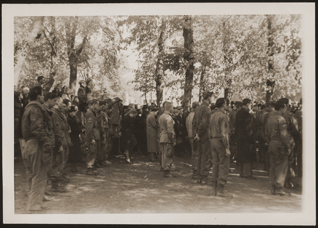 After the liberation of the Wöbbelin camp, US troops forced the townspeople of Ludwigslust to bury the bodies of prisoners killed in the camp. This photo shows US troops assembled at the mass funeral in Ludwigslust. Germany, May 7, 1945.