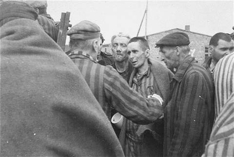 Survivors in Wöbbelin board trucks for evacuation from the camp to an American field hospital for medical attention. Germany, May 4-5, 1945.