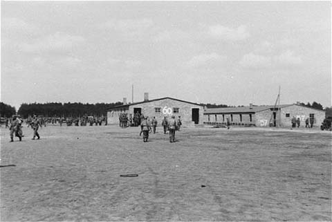 On May 2, 1945, the 8th Infantry Division and the 82nd Airborne Division encountered the Wöbbelin concentration camp. This photograph shows US troops in the Wöbbelin camp. Germany, May 4–6, 1945.
