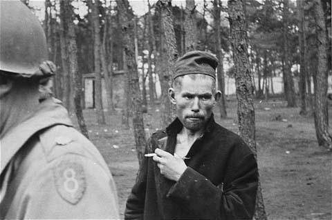 A survivor in Wöbbelin. The soldier in the foreground of the photograph wears the insignia of the 8th Infantry Division. Along with the 82nd Airborne Division, on May 2, 1945, the 8th Infantry Division encountered the Wöbbelin camp. Germany, May 4-5, 1945.