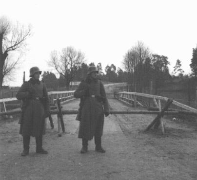 Two German sentries stand guard at Augustow on the demarcation line between Soviet- and German-occupied Poland. September 1939.