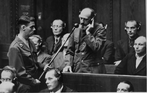 On September 15, 1947, defendant Paul Blobel pleads not guilty during his arraignment at the Einsatzgruppen Trial. Blobel was the commanding officer of a German mobile killing unit and was responsible for the massacre at Babi Yar (near Kiev). He was convicted by the military tribunal at Nuremberg and sentenced to death. Blobel was hanged at the Landsberg prison on June 8, 1951.