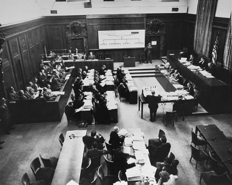 The courtroom during the Einsatzgruppen Trial. Chief Prosecutor Benjamin Ferencz stands in the center of the room.