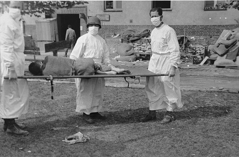 American medical personnel evacuate Langenstein survivors to a hospital. Germany, April 1945.
