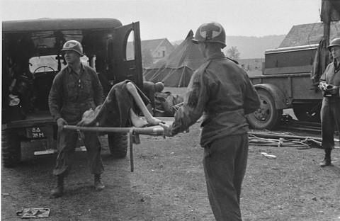 American medical personnel evacuate Langenstein survivors to a hospital. Langenstein, Germany, April 1945.