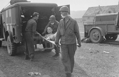 American medical personnel evacuate Langenstein survivors to a hospital. Germany, Apri 1945.