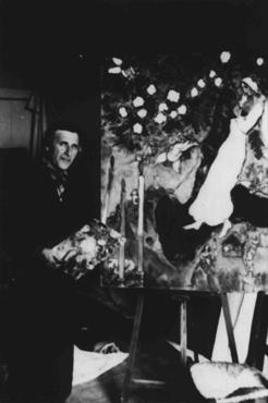 Marc Chagall, the Russian Jewish artist, at work in his studio in southern France. Gords, France, 1940.