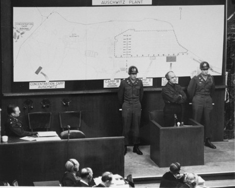 Oswald Pohl on the witness stand during the I. G. Farben Trial. Pohl, the former chief of the SS Economic and Administrative Main Office, had already been convicted by the American military tribunal at Nuremberg. While he awaited execution, Pohl was called to testify in the I. G. Farben Trial. His testimony confirmed the I. G. Farben company's use of concentration camp inmates for slave labor. November 21-24, 1947.
