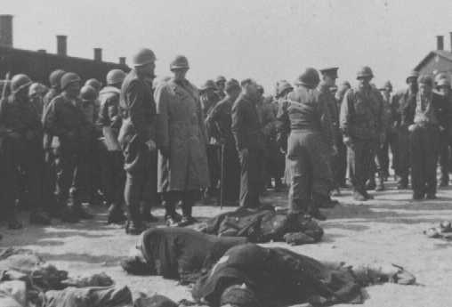 Generals Eisenhower, Patton, and Bradley view corpses of inmates at Ohrdruf, a subcamp of Buchenwald. Germany, April 12, 1945.