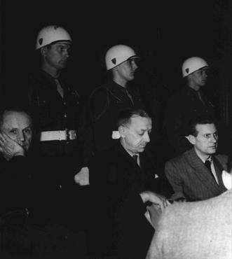 Defendants Karl Doenitz (left), Erich Raeder (center), and Baldur von Schirach under guard in the defendants' dock at Nuremberg.