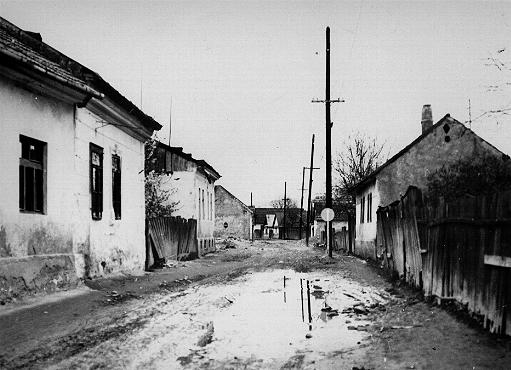 A deserted street in the area of the Sighet Marmatiei ghetto. This photograph was taken after the deportation of the ghetto population. Sighet Marmatiei, Hungary, May 1944.
