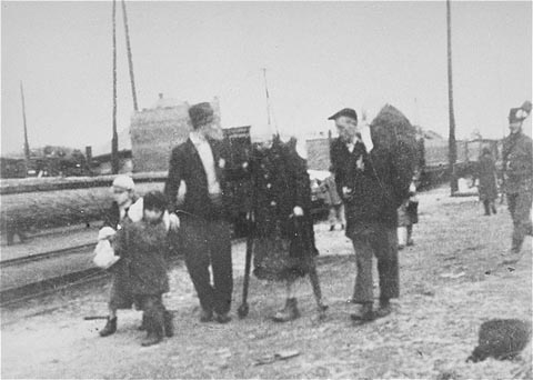 Jews bound for the rail station during deportation action from Sighet. May 18, 1944.