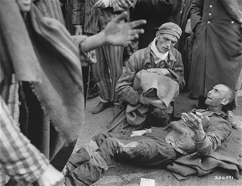 Survivors waiting for to be evacuated from the Wöbbelin concentration camp to receive medical attention at a field hospital. Germany, May 4, 1945.