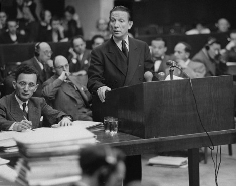 Lawyer Joseph Kaufman speaks for the prosecution during the Krupp Trial. The man sitting beside him is Vincente Czeisler, a translator. December 1947.