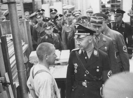 Heinrich Himmler, head of the SS, speaks to an inmate of the Dachau concentration camp during an official inspection. Dachau, Germany, May 8, 1936.