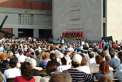 View of a ceremony held during the Museum's Tribute to Holocaust Survivors: Reunion of a Special Family, one of the Museum's tenth anniversary events. Flags of the liberating divisions form the backdrop to the ceremony. Washington, DC, November 2003.