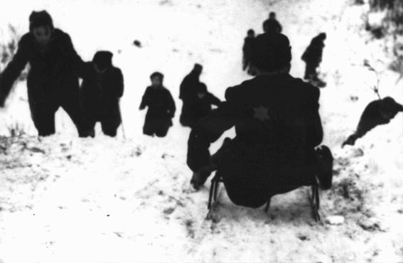 Jewish children sledding in the Kovno ghetto. Kovno, Lithuania, December 1943.