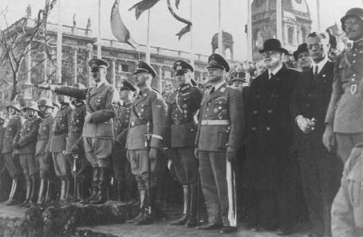 Adolf Hitler and entourage view a military parade following the annexation of Austria (the Anschluss). Vienna, Austria, March 1938.