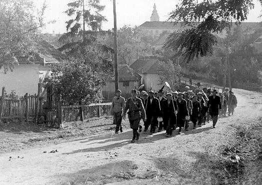 A column of Jewish forced laborers. Sarospatok, Hungary, 1941.