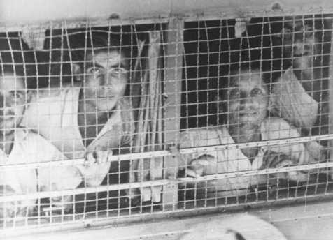 "The British arrested the passengers of the Aliyah Bet (""illegal"" immigration) ship ""Parita"" after they arrived on the Tel Aviv coast and transferred them in caged buses to Atlit detention camp. Palestine, August 21, 1939."