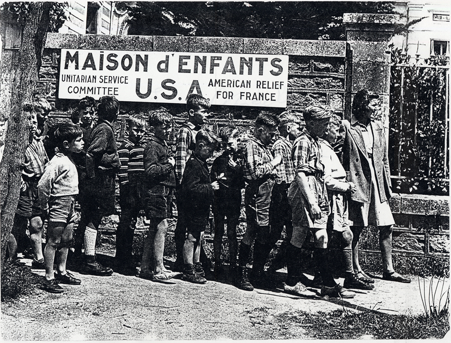 French children wait in line to receive assistance from the Unitarian Service Committee in France. Ca. 1939-1941.