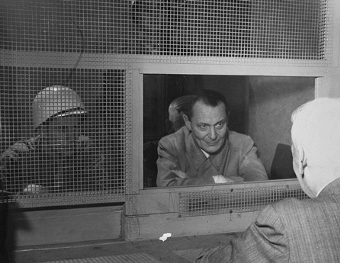 Defendant Hermann Goering consults with his lawyer, Dr. Otto Stahmer, in the Nuremberg prison. 1946.