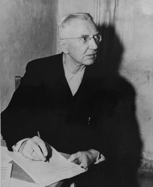 Defendant Hjalmar Schacht, former German Minister for Economics, in his prison cell at Nuremberg.
