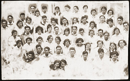 Group portrait of the members of the Zionist pioneer youth group, Ha-Shomer ha-Tsa'ir Hachshara. Kalisz, Poland, May 1, 1935.