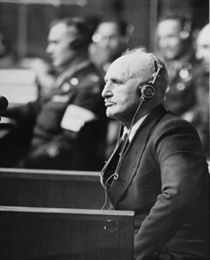 Defendant Julius Streicher, editor of the antisemitic newspaper Der Stürmer, on the stand at the International Military Tribunal trial of Major War Criminals at Nuremberg.  April 29, 1946.