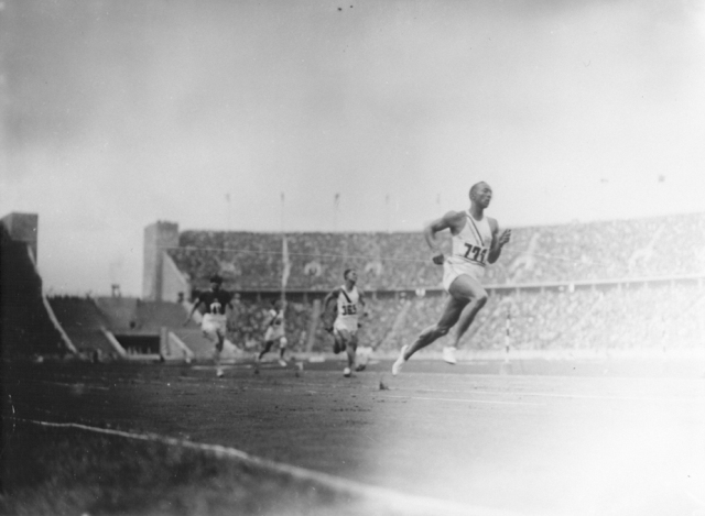 American Olympic runner Jesse Owens and other Olympic athletes compete in the twelfth heat of the first trial of the 100m dash. Berlin, Germany, August 3, 1936.