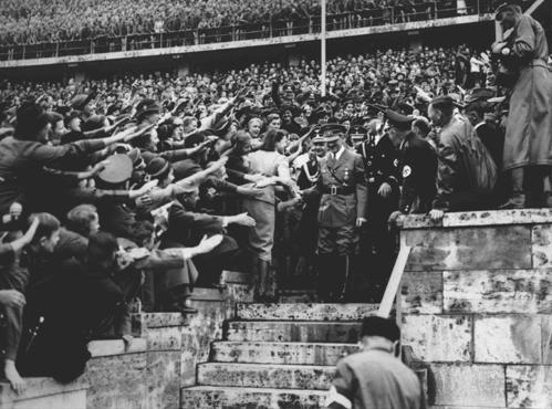 An enthusiastic crowd greets Adolf Hitler upon his arrival at the Olympic Stadium. Berlin, Germany, August 1936.