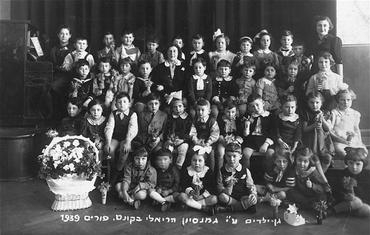 Purim portrait of a kindergarten class at the Reali Hebrew gymnasium. Kovno, Lithuania, March 5, 1939.