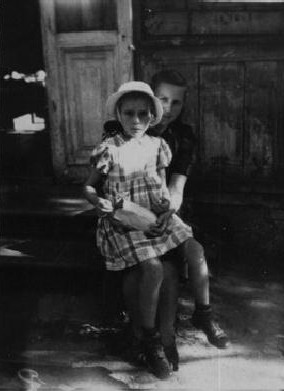 "During a roundup for deportation in eastern Poland in 1942, Gitta Rosenzweig—then three or four years old—was sent into hiding. She ended up in a Catholic orphanage. In 1946, Ida Rosenshtein, a family friend and a survivor, learned of the child's whereabouts and sought to claim her. After denying that it held a Jewish child, the orphanage relinquished custody after Ida recognized Gitta and a local Jewish committee paid a ""redemption"" fee. Gitta is pictured here on the day she left the orphanage."