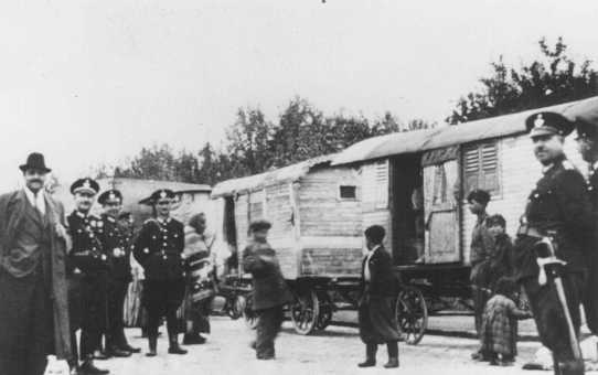Nazi police round up Romani (Gypsy) families from Vienna for deportation to Poland. Austria, September-December 1939.