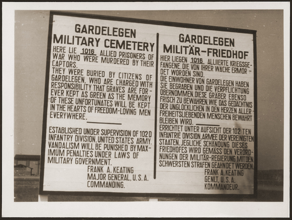 A sign at the military cemetery in Gardelegen in memory of the prisoners who were killed by the SS in a barn near the town. Germany, April 18, 1945.