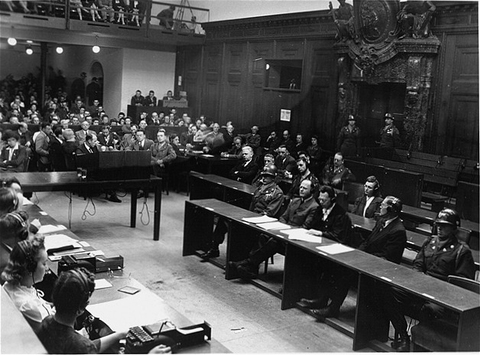 View of the courtroom during a session of the Milch Trial. Defendant Former German Field Marshal Erhard Milch is seated at the right in the front row, second from the left. He is seated to the left of his two lawyers, Dr. Friedrich Bergold and Dr. Werner Milch.