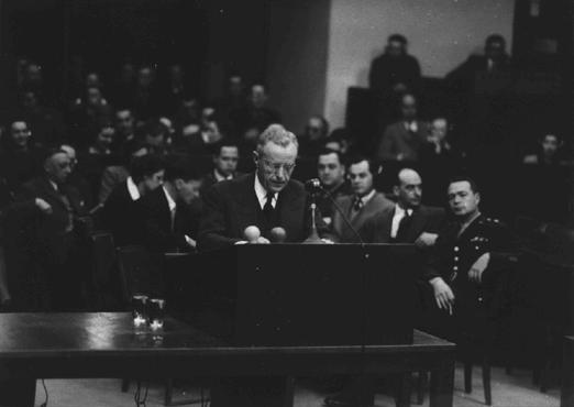 US Deputy Chief of Counsel Charles M. LaFollette at the podium during the Justice Case. Behind him is the prosecution team.