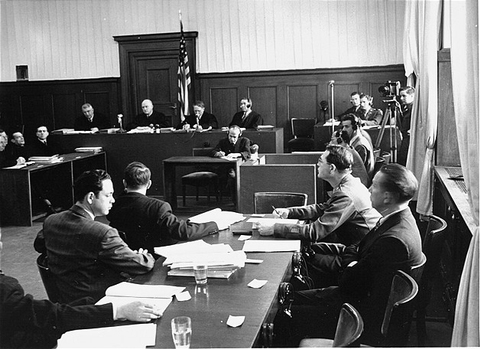 Members of the prosecution team (foreground) during a session of the Milch Trial.