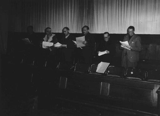 The defendants at the Flick Trial study court documents. From left to right are Bernhard Weiss, Friedrich Flick, Odilo Burkart, Konrad Kaletsch, Otto Steinbrinck, and Hermann Terberger.