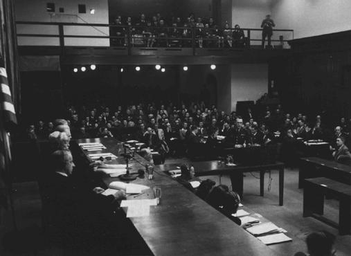 The courtroom in the Palace of Justice during the Flick Trial. US Chief of Counsel Brigadier General Telford Taylor is shown at the podium in the center, and the judges' bench is in the left foreground.