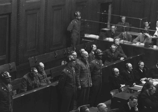 Former German General Lothar Rendulic is sentenced to 20 years in prison. He is flanked by US military guards.  February 19, 1948.