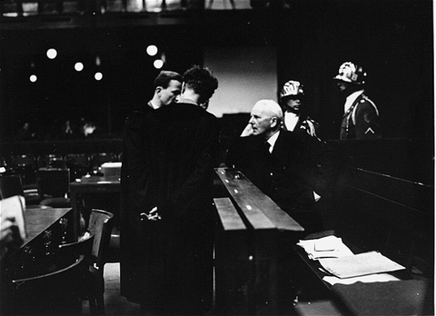 Ernst von Weizsaecker, former German State Secretary and Ambassador to the Vatican, speaks with his son, Richard (his co-defense counsel), and Dr. Harmut Becker, his main lawyer, during the Ministries Trial.