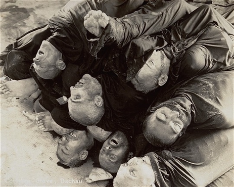 Close-up of corpses piled in the crematorium mortuary in the newly liberated Dachau concentration camp. Dachau, Germany, May 1945.